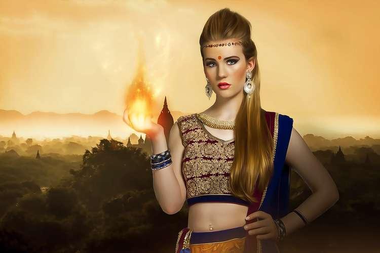 Plakat kobiety z płomieniem w ręku